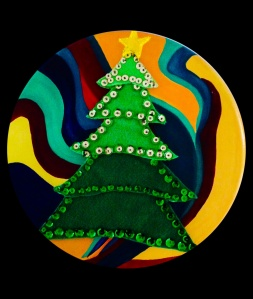 Anna's first sewing project, a Christmas tree and the top of a stool painted by artist Joann Goetzinger