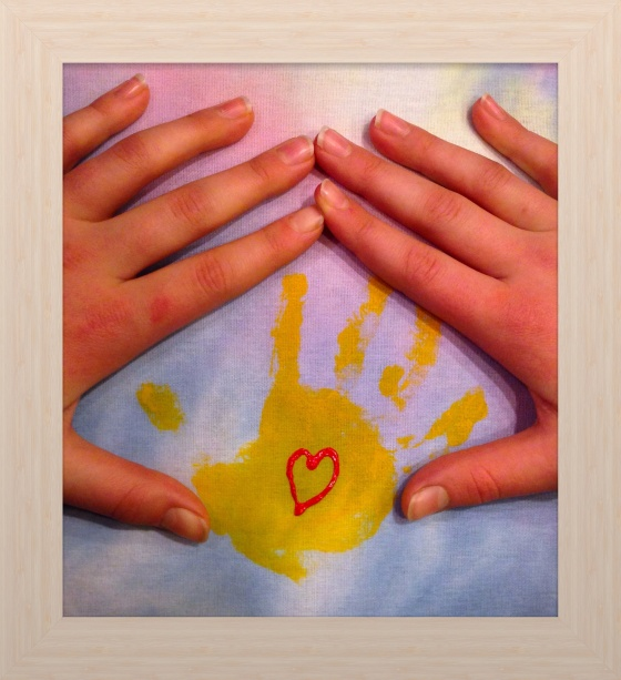 Painted hand from my girl when she was small and her hands now showing how they have grown.