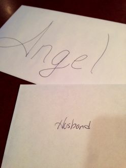 Two envelopes with the name Angel on one and Husband on the other.