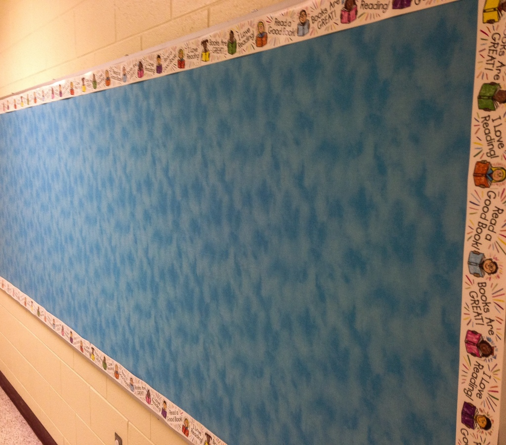Empty grade school bulletin board symbolizing loss