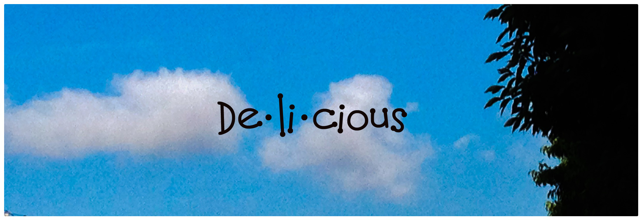 Clouds and blue sky with the word delicious in the sky.