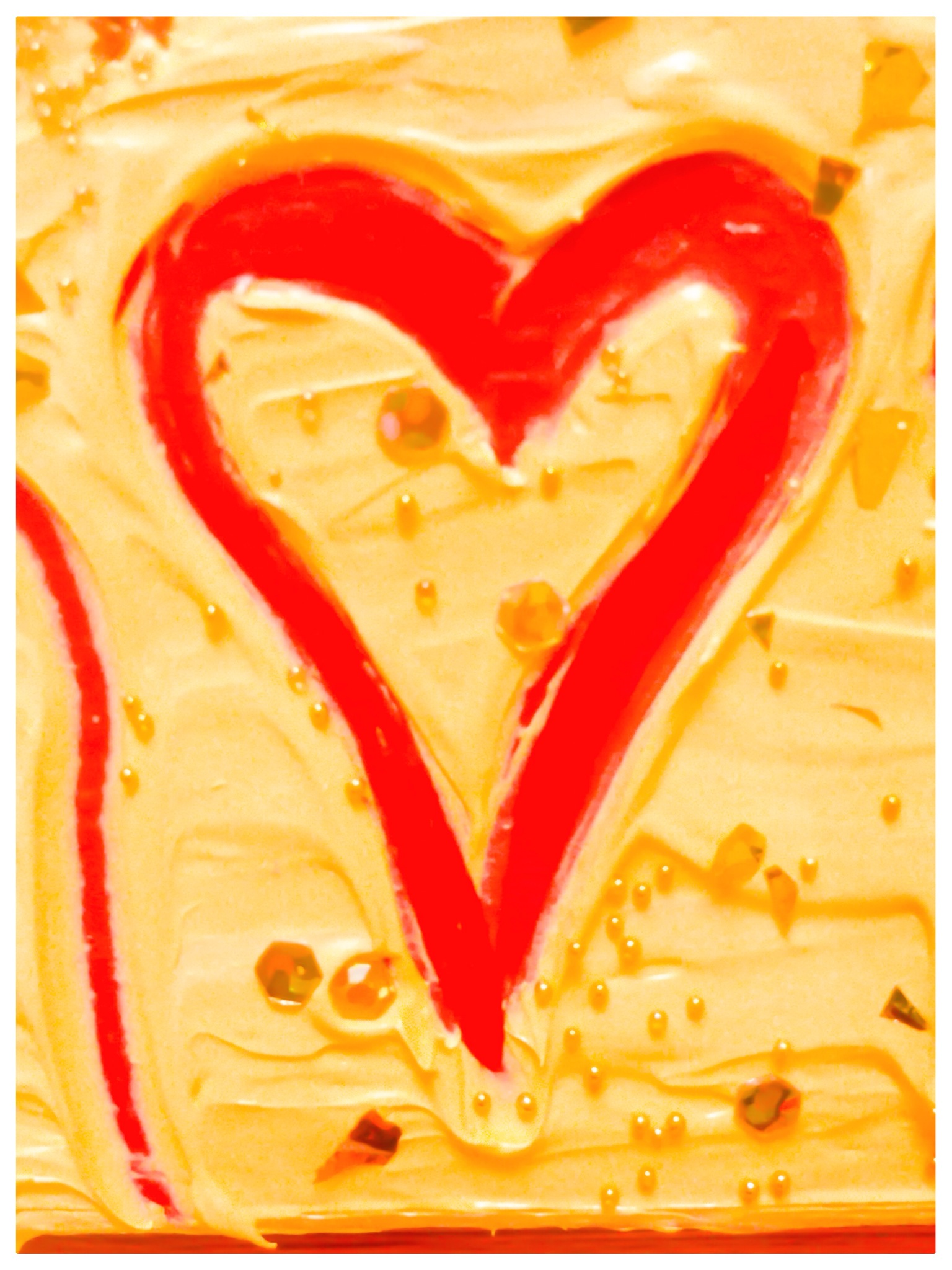 Painted image of a red heart in yellow paint.