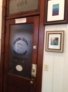 The inside of my studio door with a banner over the doorway.