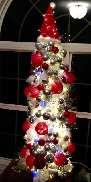 Image of the Christmas tree my daughter and I made out of a tomato cage and LOTS of red and silver balls and lights!