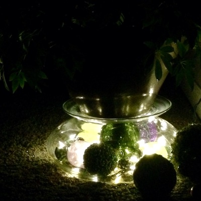 Glass bowl with white lights and decoration makes a great night light.