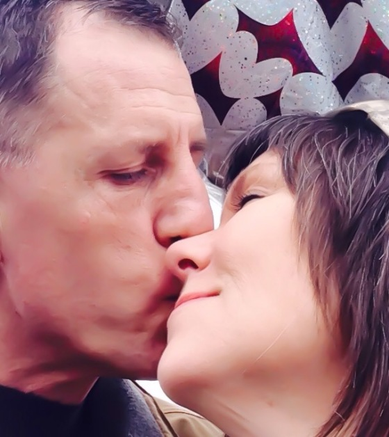 My sweet husband kissing my face.