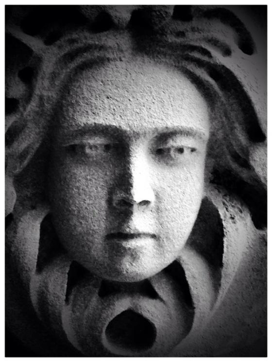 Stone portrait of a woman gazing outwardly.